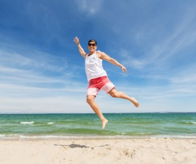 Beach hopping man Stock Photo