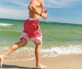 Beach man running Stock Photo