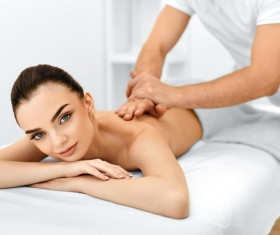 Beautician for the customer body care Stock Photo