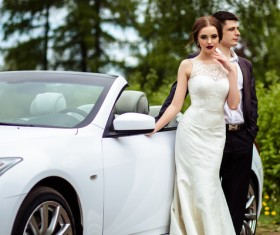 Beautiful bride and groom near the wedding car Stock Photo 01