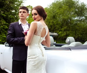 Beautiful bride and groom near the wedding car Stock Photo 02
