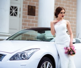 Beautiful bride near the wedding car Stock Photo 01