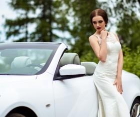 Beautiful bride near the wedding car Stock Photo 02