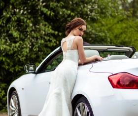 Beautiful bride near the wedding car Stock Photo 03