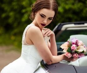 Beautiful bride near the wedding car Stock Photo 04