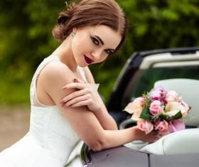 Beautiful bride near the wedding car Stock Photo 05