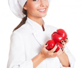 Beautiful female chef holding a tomato Stock Photo 01