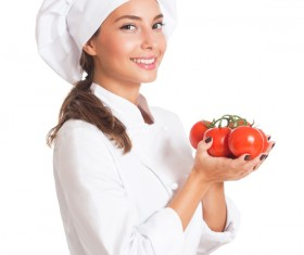 Beautiful female chef holding a tomato Stock Photo 02