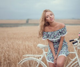 Beautiful girls with bicycle Stock Photo