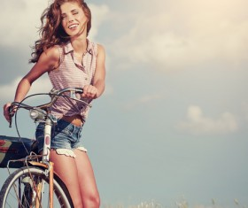 Beauty riding a bike tour Stock Photo