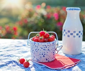 Cherry Tomatoes and bottled milk on the table Stock Photo