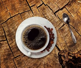 Coffee on a wooden cracked table Stock Photo