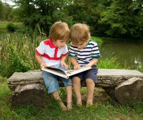 Comic books together to see two children Stock Photo