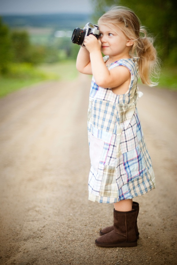 Cute Small Blonde Girl Posing With Camera Stock Photo Free -4098
