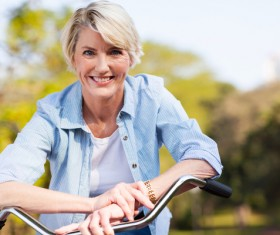 Cycling middle-aged women Stock Photo