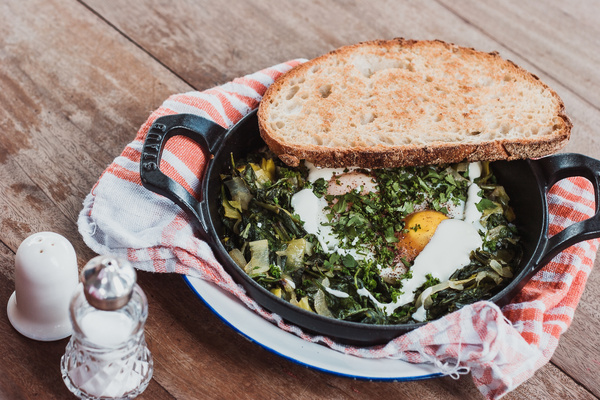 Delicious traditional breakfast with eggs and bread Stock Photo