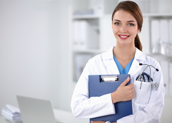 Female doctor holding medical records Stock Photo