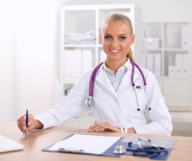 Female doctor write disease cure Stock Photo 02