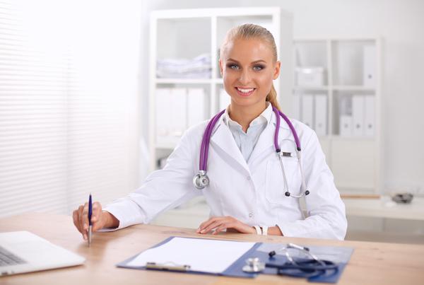 Female doctor write disease cure Stock Photo 02