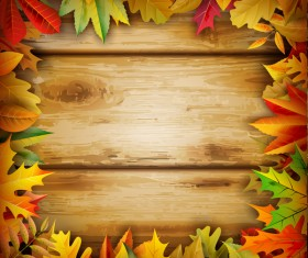 Frame autumn leaves and wooden background vector