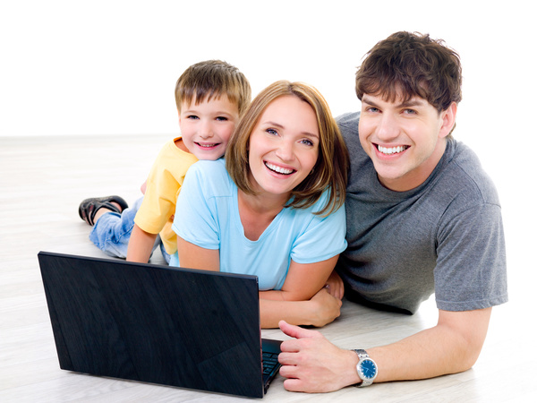 Happy family before the computer Stock Photo