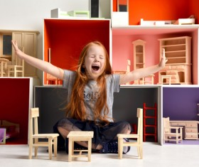Happy little girl playing doll house filled with mini furniture toys Stock Photo 08