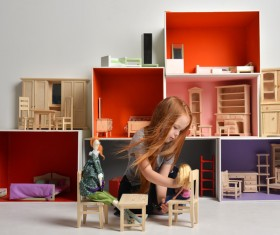 Happy little girl playing doll house filled with mini furniture toys Stock Photo 09