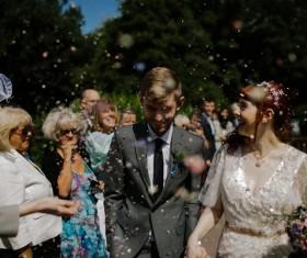 Happy marriage couple among cheering Stock Photo