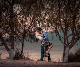 Hug kissing couple Stock Photo