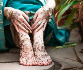 Indian women show hands feet Mehndi Stock Photo