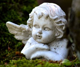 Little angel stone statue Stock Photo