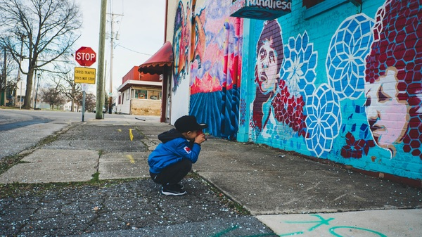 Little boy and colored painted wall Stock Photo