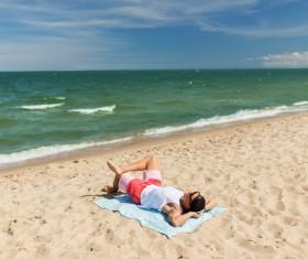 Man lying on the beach Stock Photo