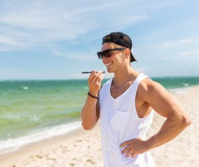Man talking on the phone at the beach Stock Photo