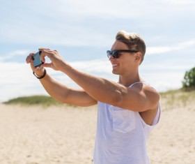 Man with smart phone self-timer Stock Photo 01