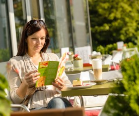 Outdoor cafe reading the menu of woman Stock Photo