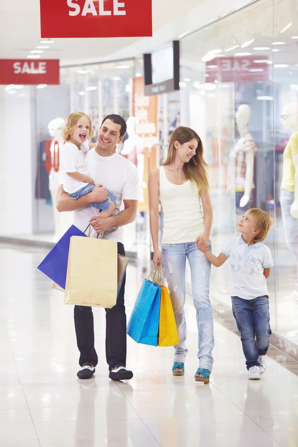 Parents with children shopping Stock Photo
