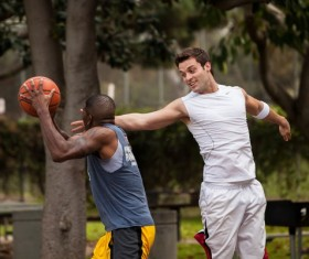 Playing basketball boys Stock Photo