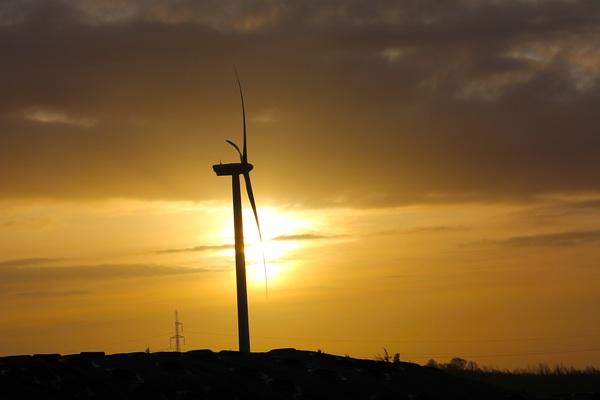 Power windmill at dusk Stock Photo