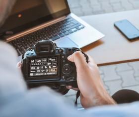 Setting digital camera man Stock Photo