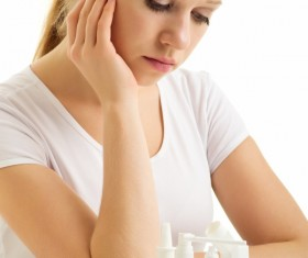 Sick girl with medicine on the table Stock Photo 01