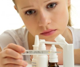 Sick girl with medicine on the table Stock Photo 02