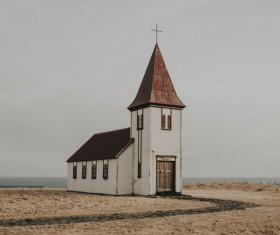 Simple church on seaside scene Stock Photo