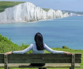 Sitting in a chair to rest on the woman looking at the distant scenery Stock Photo