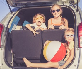 Sitting in the car trunk in children Stock Photo