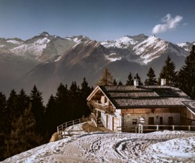 Small cottage on cold snow mountain Stock Photo