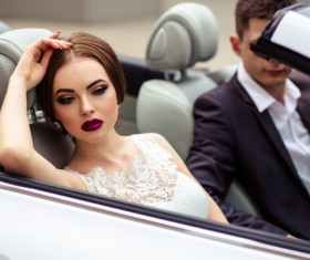 Stock Photo The bride and groom sitting in the wedding car 01