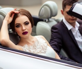 Stock Photo The bride and groom sitting in the wedding car 02