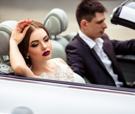 Stock Photo The bride and groom sitting in the wedding car 04