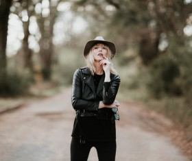 Stylish woman posing with leather coat Stock Photo